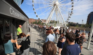 Fans queue at the Echo Arena box office in Liverpool for tickets to the gig at the Cavern club.
