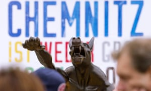 Sculptures by artist Rainer Opolka in Chemnitz, eastern Germany. The figure in the centre is one of 10 life-sized metal wolf sculptures as a part of the exhibition 'Wolves with Hitler salute howl in front of the Karl-Marx-Monument', to protest against xenophobia and right-wing extremism.