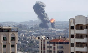 An explosion is seen during Israeli air strikes in Gaza on 27 October.