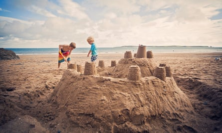 Two boys building a sandcastle