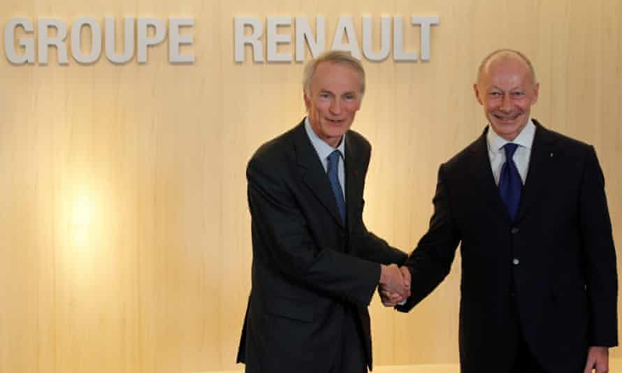 Jean-Dominique Senard (left), the newly appointed Chairman of Renault, shakes hands with Thierry Bolloré, who is the new chief executive.