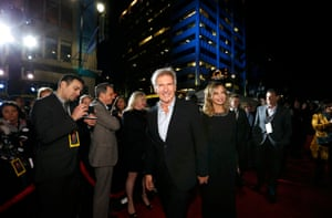 Harrison 'Han Solo' Ford keeps it casual in an unbuttoned powder-blue shirt and black jacket, with his wife, actor Calista Flockhart.