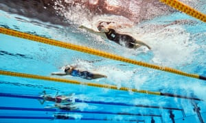 A different view of Anastasia Pagonis (second right) and Netherland's Liesette Bruinsma (right) compete in the Women's 400 m Freestyle - S11 final.