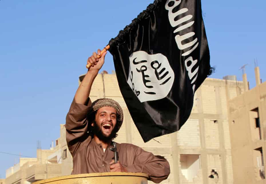 June 2014: An Isis fighter in Raqqa province celebrates after the group's capture of territory in Iraq leads it to declare a worldwide Islamic 'caliphate'