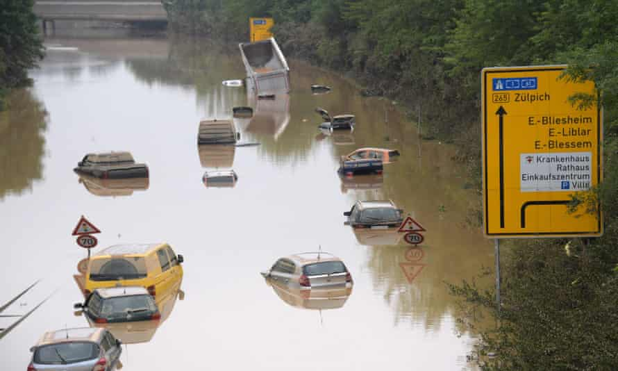 Submerged cars and other vehicles seen after flooding in Erftstadt, western Germany