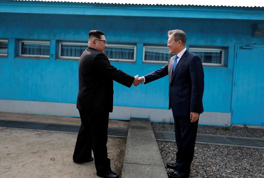 Moon Jae-in and Kim Jong-un shake hands