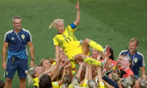 Caroline Seger of Sweden and her teammates celebrate following their sides victory.