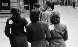 "Lithuanian Jews with compulsory ""J"" badges separating them from the Aryan population, 1941."