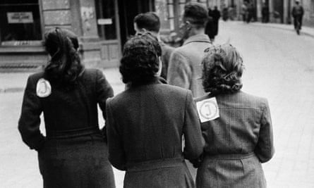 """Lithuanian Jews with compulsory """"J"""" badges separating them from the Aryan population, 1941."""