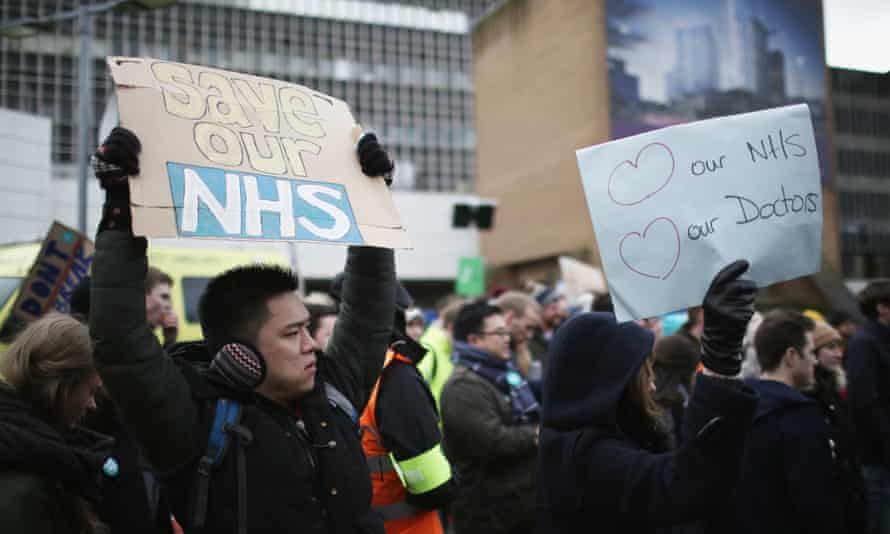 NHS workers outside the Royal Liverpool University hospital during a strike in March
