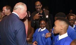 Prince Charles meets Lenny Henry and schoolchildren at a visit to the Royal Albert Hall, London