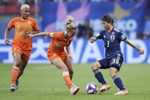 Japan's Aya Sameshima, right, goes past Netherlands' Jackie Groenen as Shanice Van De Sanden, left, looks on.