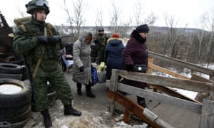 Civilians seen at Stanitsa Luganskaya, the only active checkpoint for them to cross the border between Ukraine and the Lugansk People's Republic, a Russian-backed enclave in eastern Ukraine.