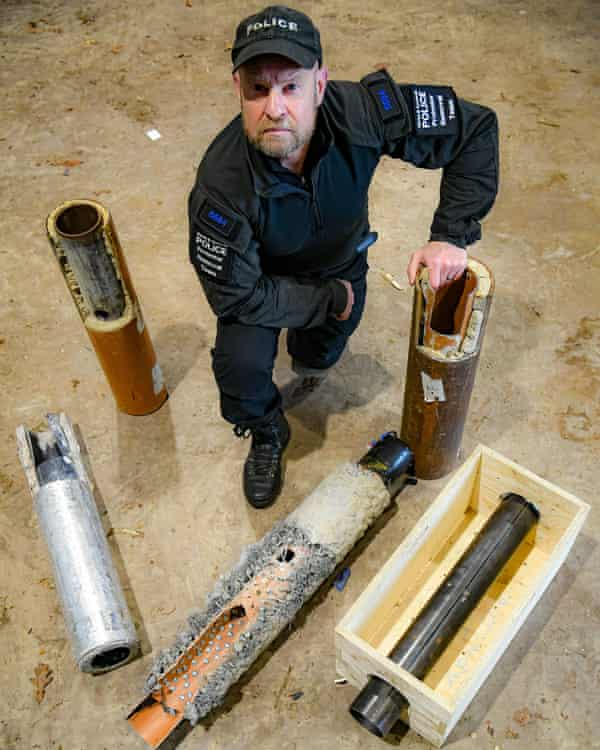 An officer displays some of the assorted 'lock-on' devices at its headquarters in Exeter.