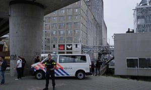 A policeman stands as police evacuate the Maassilo, after the Allah-Las concert was cancelled because of a terror threat.