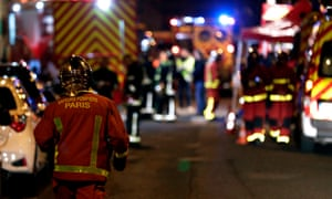 Firefighters at the apartment building that caught fire in the 16th arrondissement of Paris.