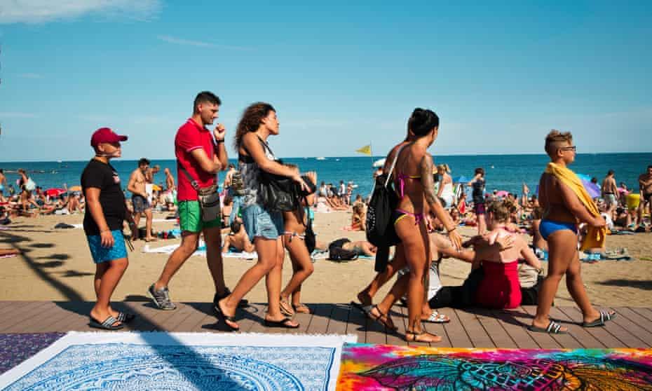 Sunseekers on the beach at La Barceloneta.