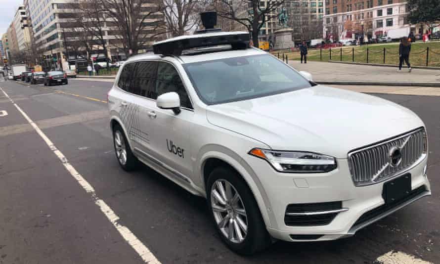 An Uber car equipped with cameras and sensors drives the streets of Washington DC