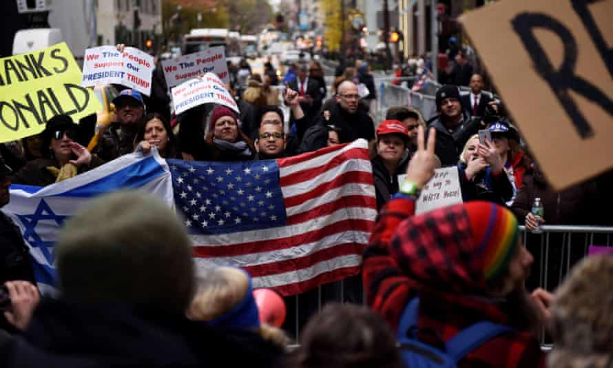 Supporters of President-elect Trump stand across from a crowd of anti-Trump protesters near Trump Tower in New York City.