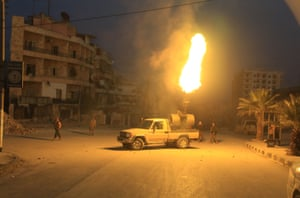 Free Syrian Army fighters aim anti-aircraft artillery at Russian fighter jets