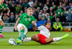 Republic of Ireland's James McClean is thwarted by Switzerland's Kevin Mbabu.