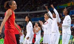 The USA bench celebrate as Spain's point guard Laia Palau contemplates defeat