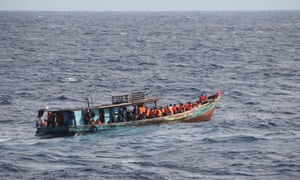 An asylum-seeker interception operation off Christmas Island in 2013. An Australia landing party is on board the vessel seeking to assess the situation and determine whether the vessel was seaworthy.