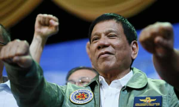 President Rodrigo Duterte gives a fist salute during a visit to the Philippine air force headquarters in suburban Pasay city, south-east of Manila.