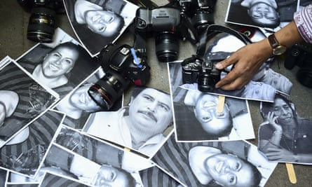 Photos of killed journalists displayed in Mexico City in February last year.