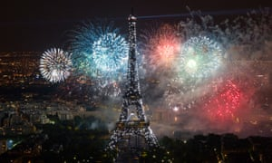 The Eiffel Tower, illuminated during the traditional Bastille Day fireworks display in Paris.