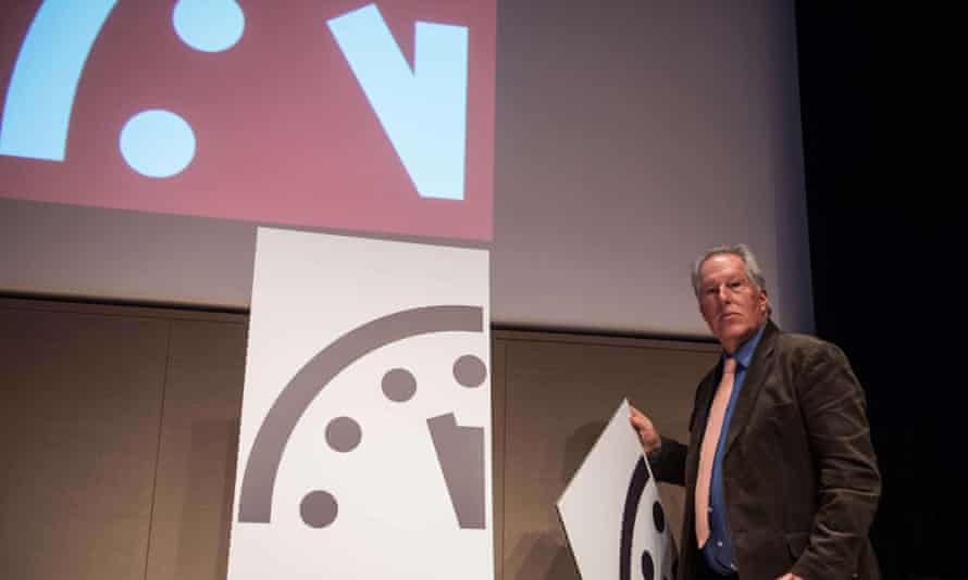 Professor Richard Somerville of the University of California in San Diego unveils the doomsday clocks, which says the world is now 'three minutes' away from apocalypse.