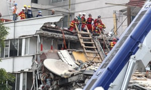 Rescue brigades search for victims among collapsed buildings in Mexico City.