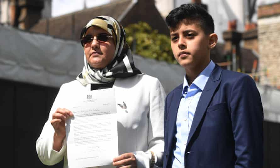 Fatima Boudchar and her son Abderrahim outside parliament in London