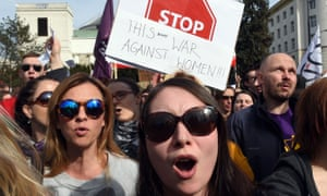Protesters rally in Warsaw against a possible tightening of Poland's abortion law.