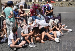 People shelter from the sun in St Peter's Square, Vatican City.