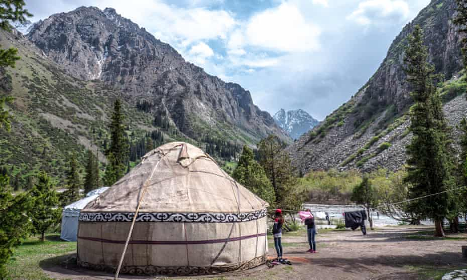The Ala Archa region of Kyrgyzstan. Yurts with entire families are positioned next to the rivers.