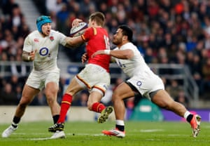 Liam Williams is stopped by Jack Nowell and Manu Tuilagi.