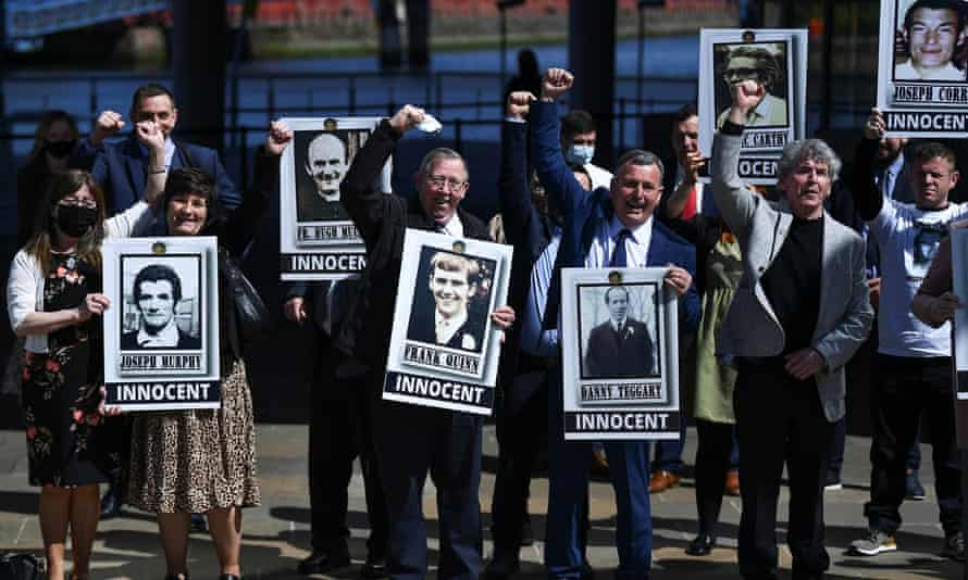 Relatives of the Ballymurphy victims with posters showing photographs of their loved ones