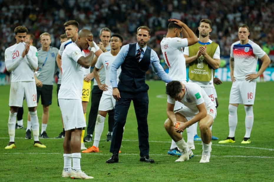 Gareth Southgate consoles his players.