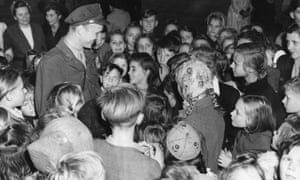 Berlin children thank Lieutenant Gail Halvorsen for the thousands of packages of gum and candy he and his friends dropped over Berlin, 1949.