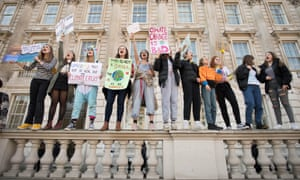 Students from the Youth Strike 4 Climate movement during a climate change protest in London on 15 February.