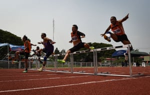 Men in the 60-65 age category competing in the 100-metre hurdles