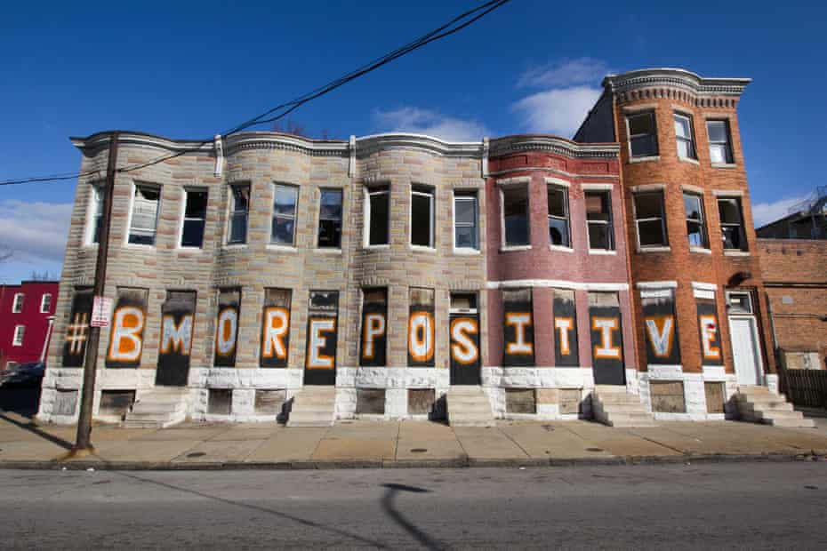 A sign on vacant homes in Baltimore.