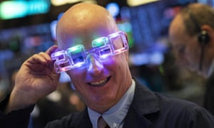 Stock trader John O'Hara tries on his New Year's 2020 party glasses at New York Stock Exchange