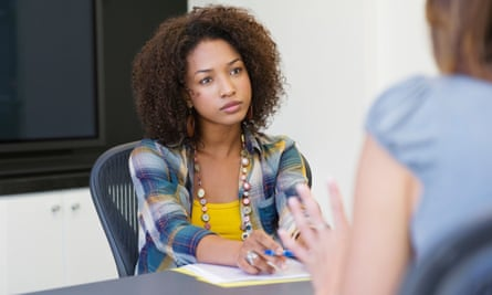 Woman sitting at table during interview