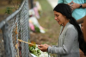 Leila Abdallah, the mother of three children killed in Sydney on Saturday when a car allegedly hit them after mounting the footpath where they were walking, visits the scene of the collision.