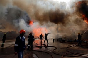 Ahmedabad, India. Firefighters attempt to douse a fire that broke out at a wood store