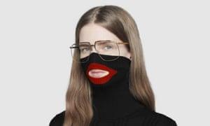 female model wearing Gucci turtleneck black wool balaclava sweater