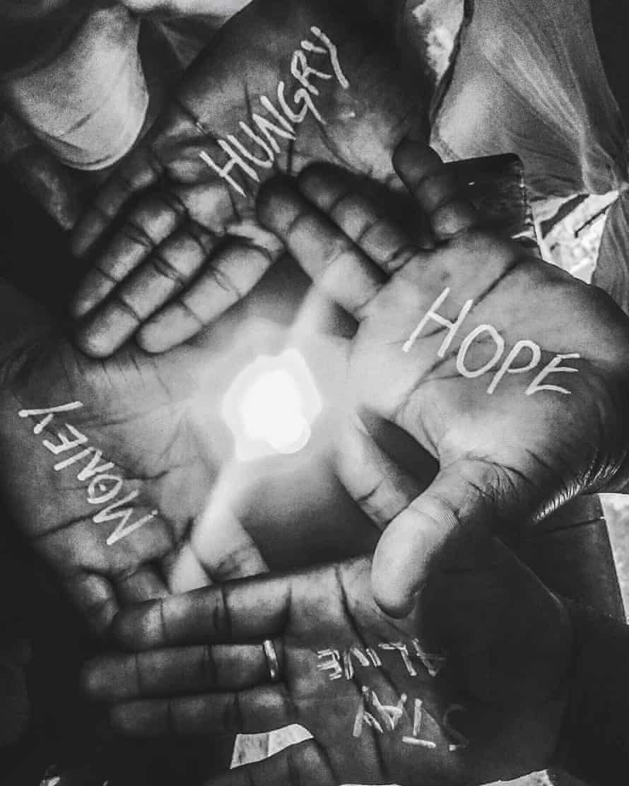 Outstretched hands with words including hope, hungry and money.