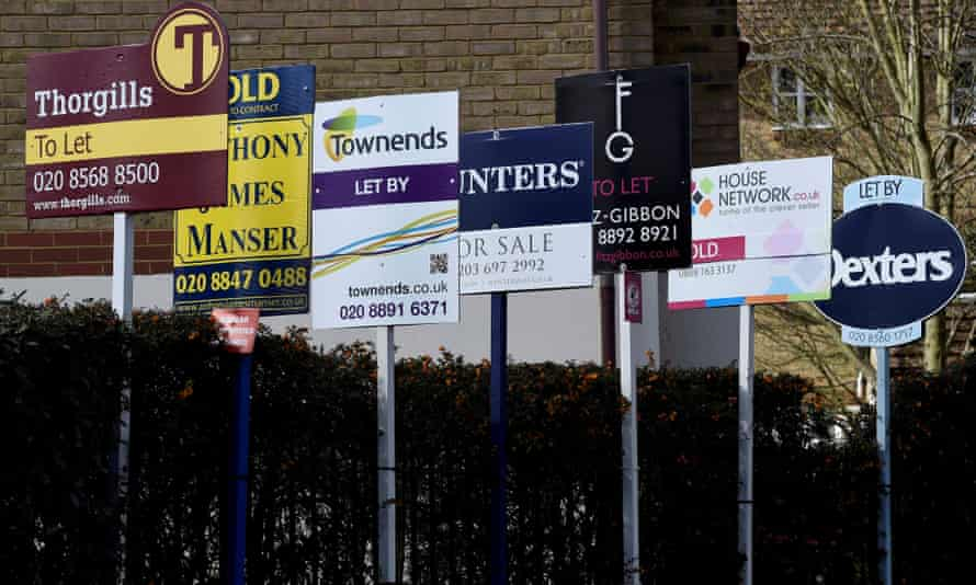 Row of estate agent signs
